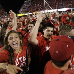 Utah fans storm the field after the Utes beat BYU in Salt Lake City  Sunday, Sept. 16, 2012.