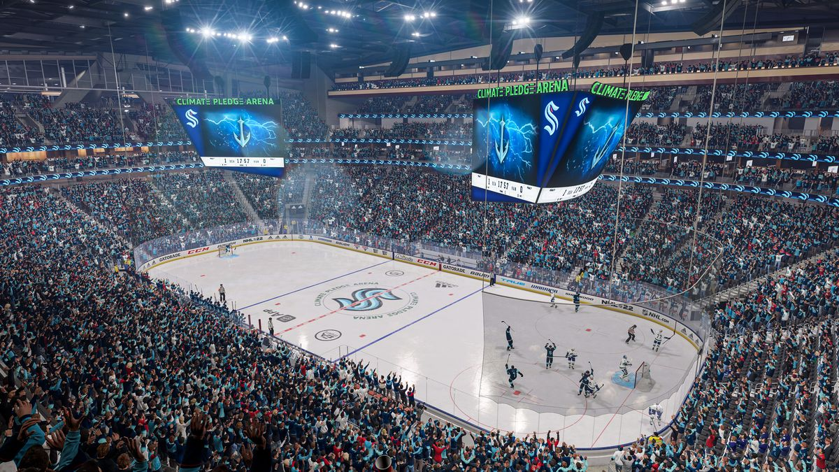 Seattle Kraken players and fans celebrating a goal at Climate Pledge Arena in NHL 22