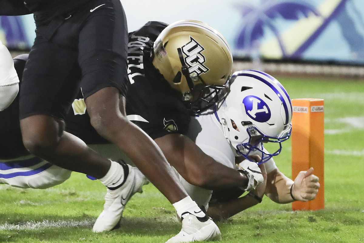 Brigham Young Cougars quarterback Zach Wilson (1) scores on UCF Knights defensive back Jon Powell.