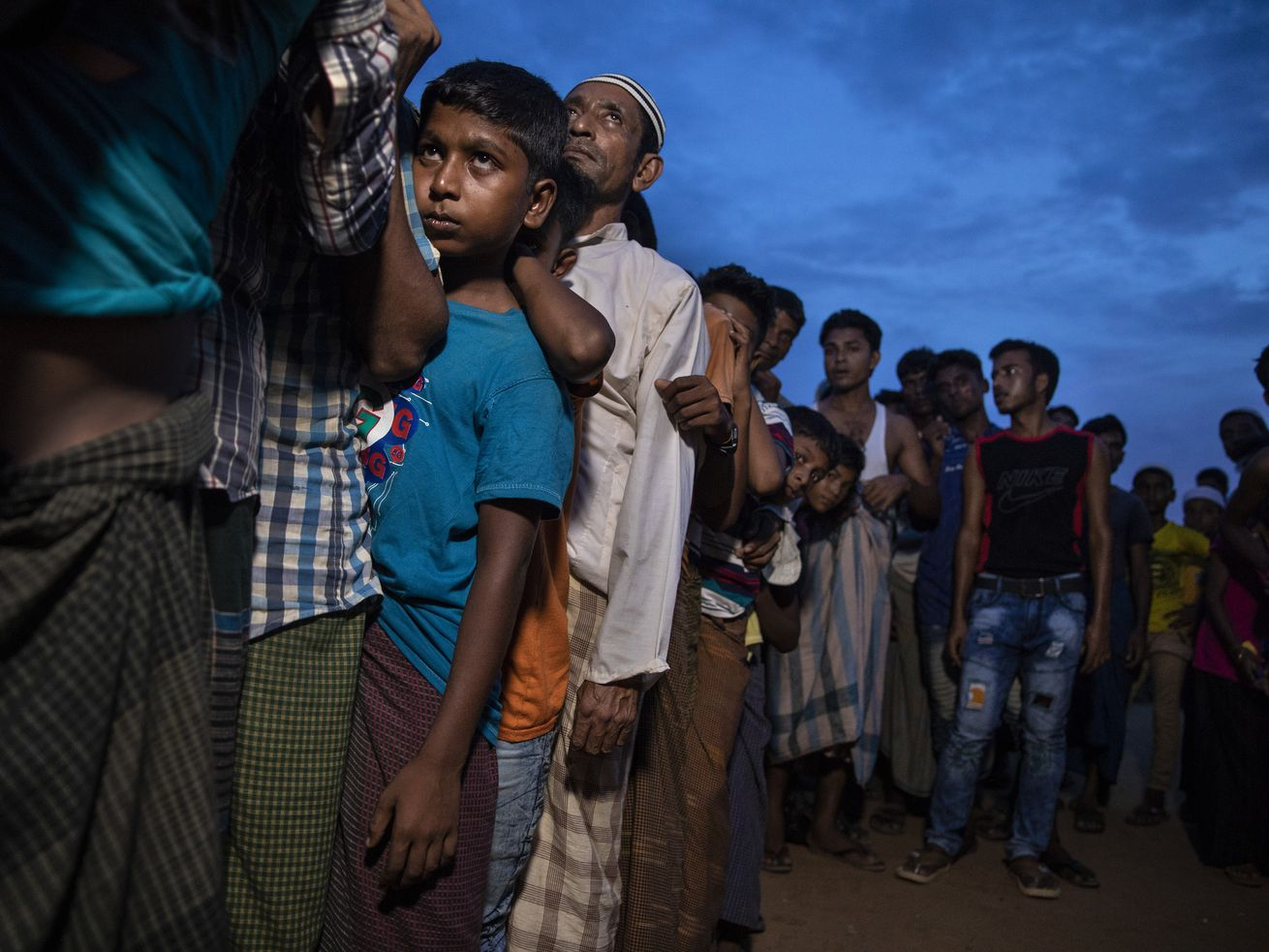 Rohingya refugees wait in Cox's Bazar, Bangladesh, in August 2018.