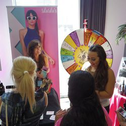 Attendees spin the wheel for a chance to win prizes from online boutique Lulu's.