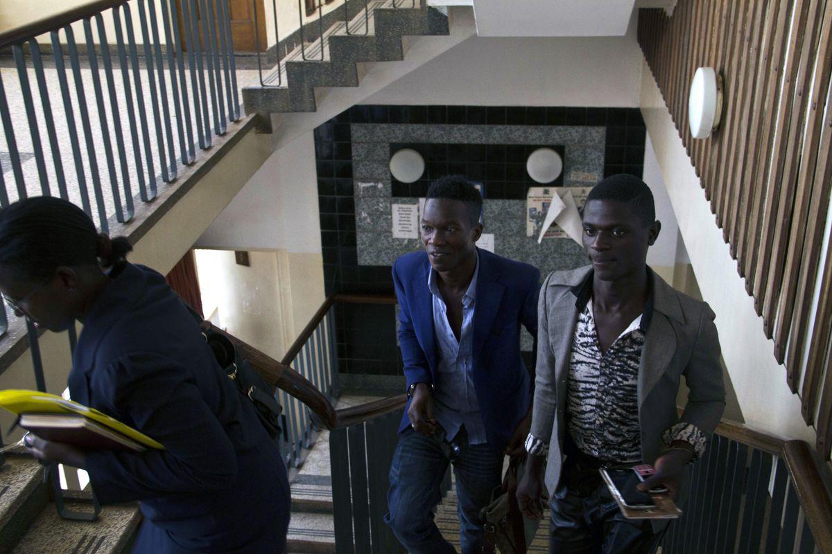 Jackson Mukasa (R) and Kim Mukisa (L) arrive at the Buganda road Magistrates Court on June 12, 2014.