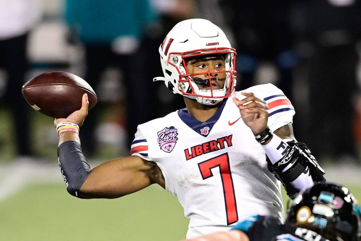Liberty Flames quarterback Malik Willis looks to pass the ball during the second quarter against the Coastal Carolina Chanticleers during the Cure Bowl at Camping World Stadium.