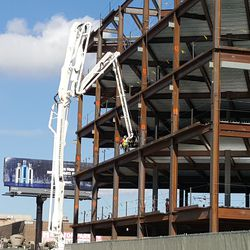 10:41 a.m. Work on west side of plaza building -
