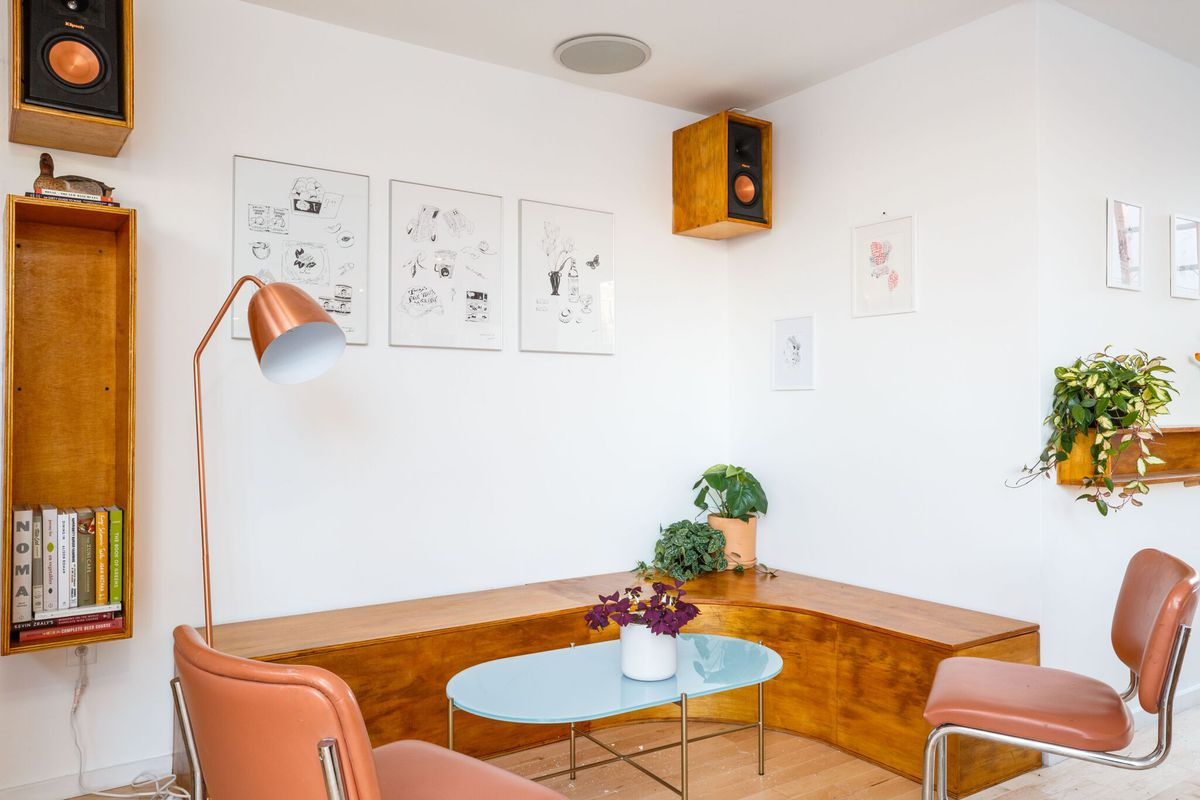 Gertie's dining room includes a blue table and a wooden bench