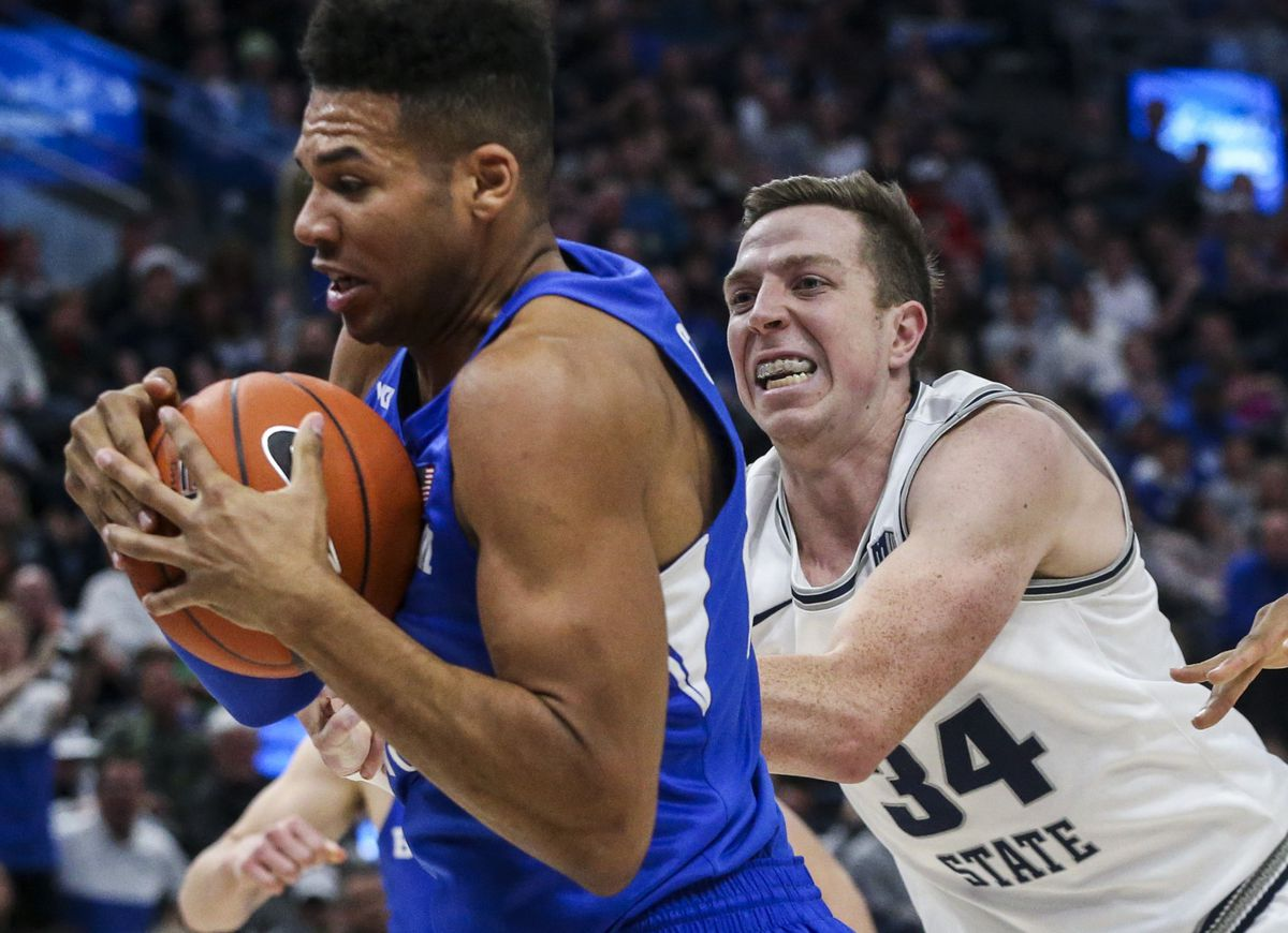 Brigham Young Cougars forward Yoeli Childs (23) protects a rebound from Utah State Aggies forward Justin Bean (34) during the second half of an NCAA basketball game in the Beehive Classic at Vivint Arena in Salt Lake City on Saturday, Dec. 14, 2019. BYU defeated Utah State 68-64 in regulation.