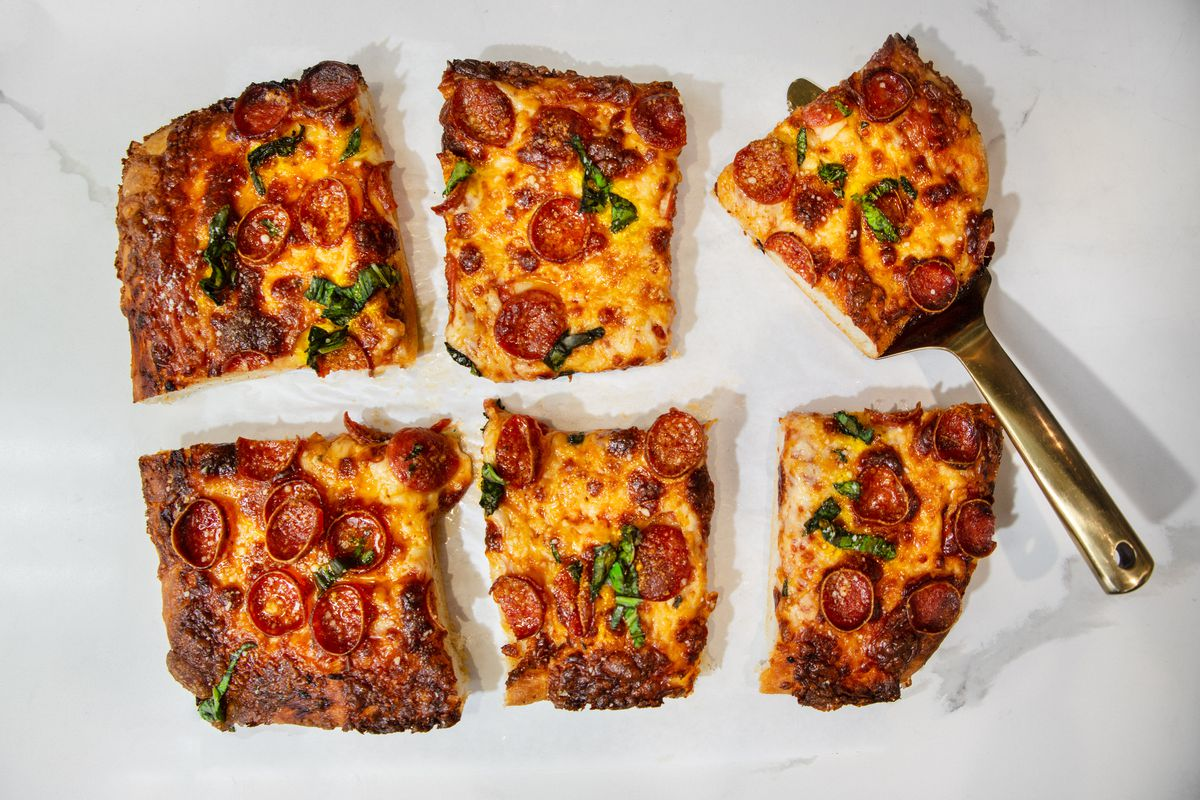 A square pizza cut in six pieces