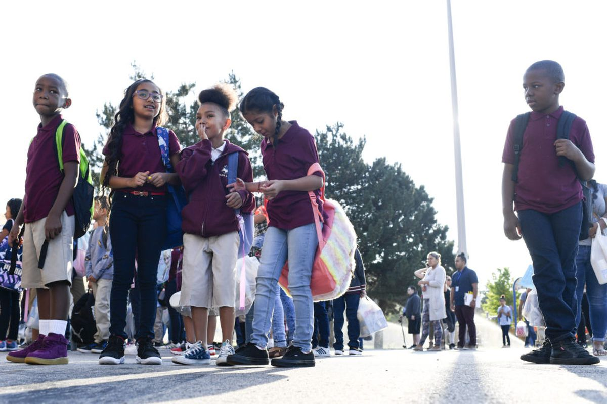 Students wait for the bell to ring on the first day of school at McGlone Academy on Wednesday. (Photo by AAron Ontiveroz/The Denver Post)