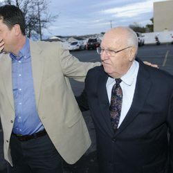 John Dehlin walks with his father David Dehlin prior to a disciplinary council held by The Church of Jesus Christ of Latter-day Saints, Sunday, Feb. 8, 2015, in North Logan, Utah.