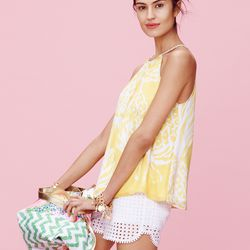 'Pineapple Punch' halter top, $26; eyelet shorts in white, $26; charm bracelets in gold, $20 each; 'Nosie Posey' weekender bag, $50
