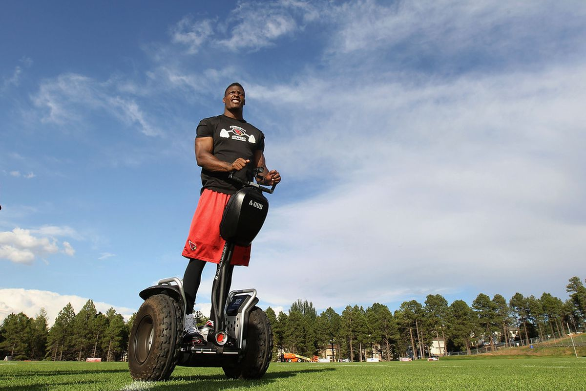FLAGSTAFF, AZ - AUGUST 04:  Safety Adrian Wilson #24 of the Arizona Cardinals leaves on a segway following the team training camp at Northern Arizona University on August 4, 2011 in Flagstaff, Arizona.  (Photo by Christian Petersen/Getty Images)