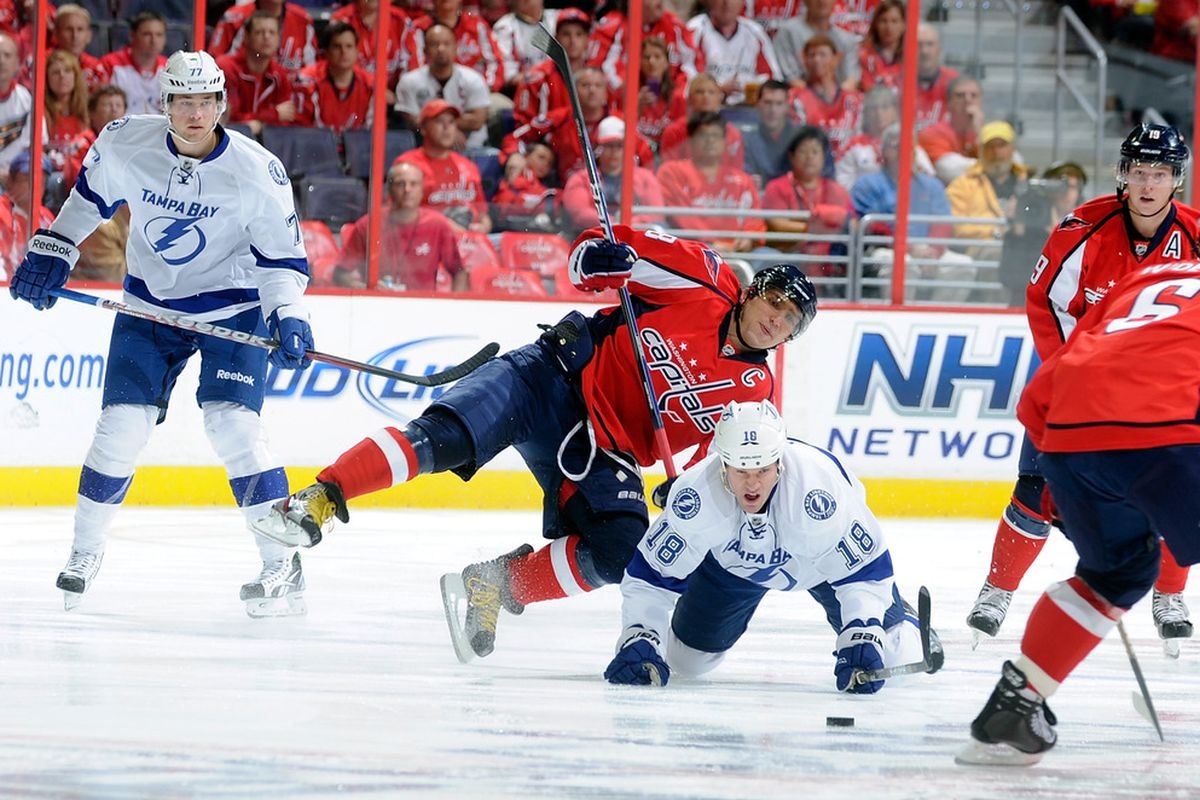 WASHINGTON, DC - OCTOBER 10:  Alex Ovechkin #8 of the Washington Capitals battles for the puck with Adam Hall #18 of the Tampa Bay Lightning at the Verizon Center on October 10, 2011 in Washington, DC.  (Photo by Greg Fiume/Getty Images)