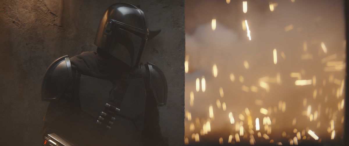 The Mandalorian takes cover as his breaching charge caves in the wall of The Client's compound.