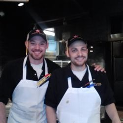 Insider-y fun at Hill Country: Bartender Robbie Finkle, left, dresses as pitmaster Rob Sonderman.