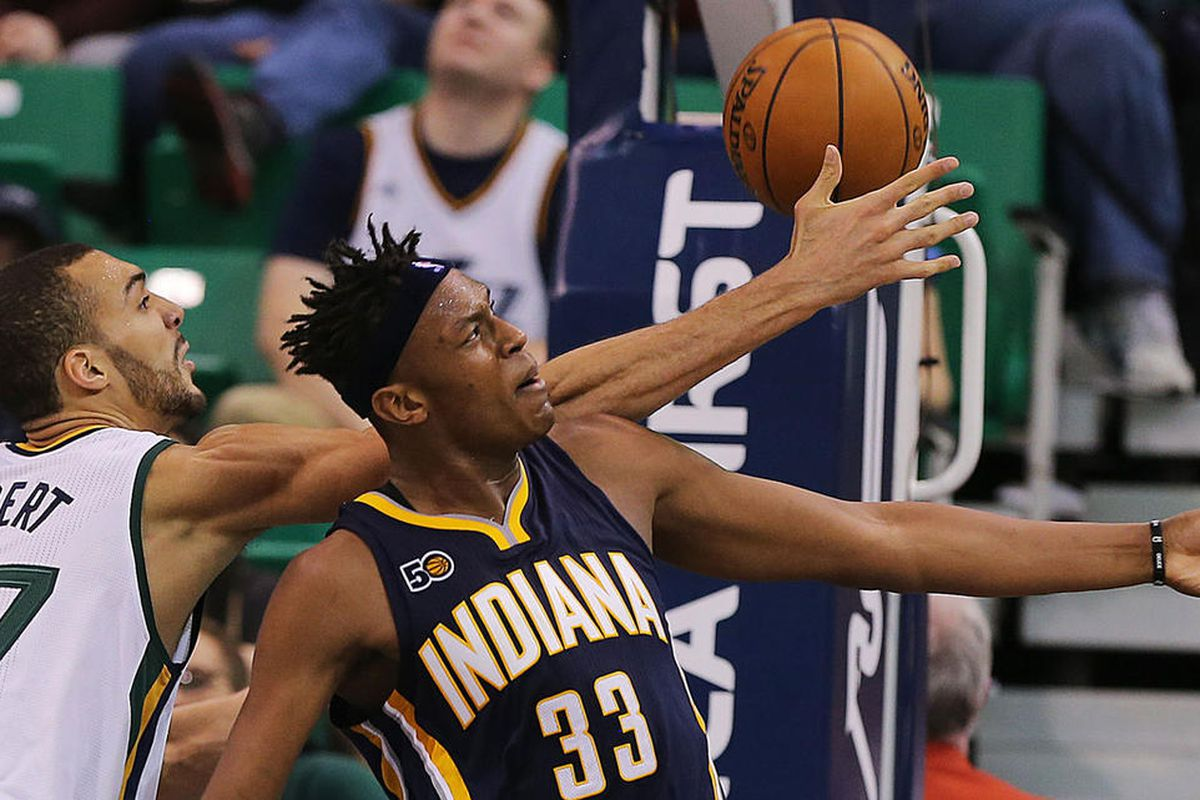 Utah Jazz center Rudy Gobert (27) and Indiana Pacers center Myles Turner (33) battle for a rebound as the Jazz and the Pacers play at Vivint Smart Home Arena in Salt Lake City on Saturday, Jan., 21, 2017.