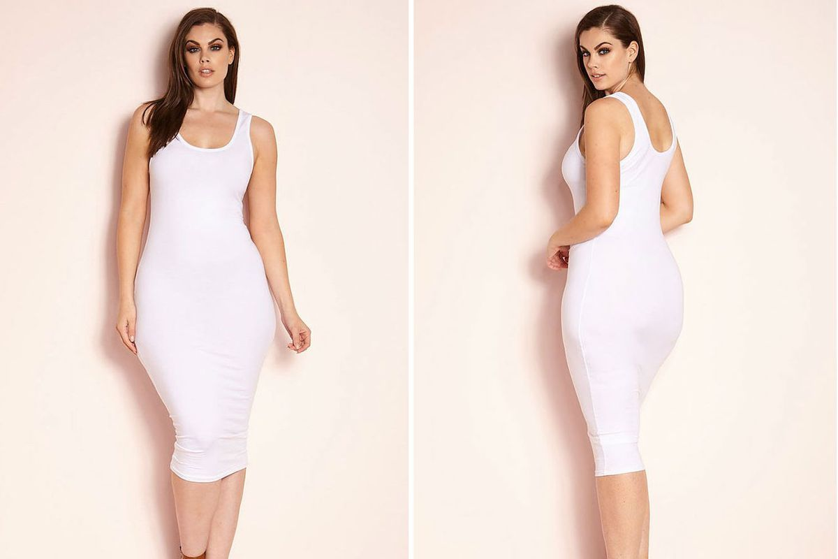 A model wearing a fitted white tank dress