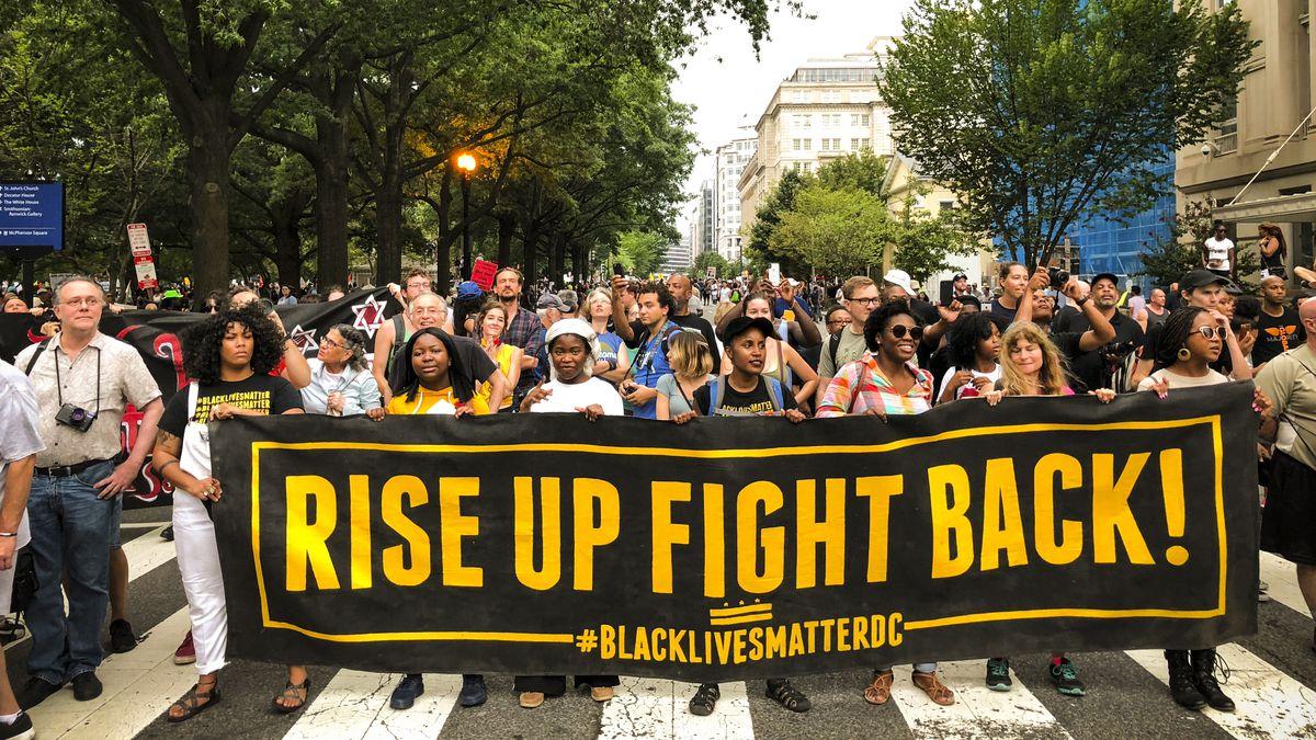 Protestors march against the far-right's Unite the Right rally in Washington D.C.
