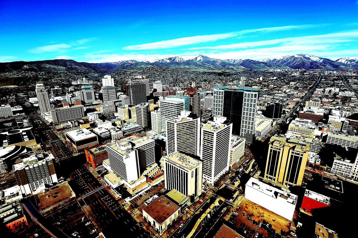 FILE - Aerial view of Salt Lake City, Wednesday, March 9, 2016. Thousands of representatives of more than 300 NGOs from around the world are expected to come to Salt Lake City in August 2019 for what's being called the biggest international event in the s
