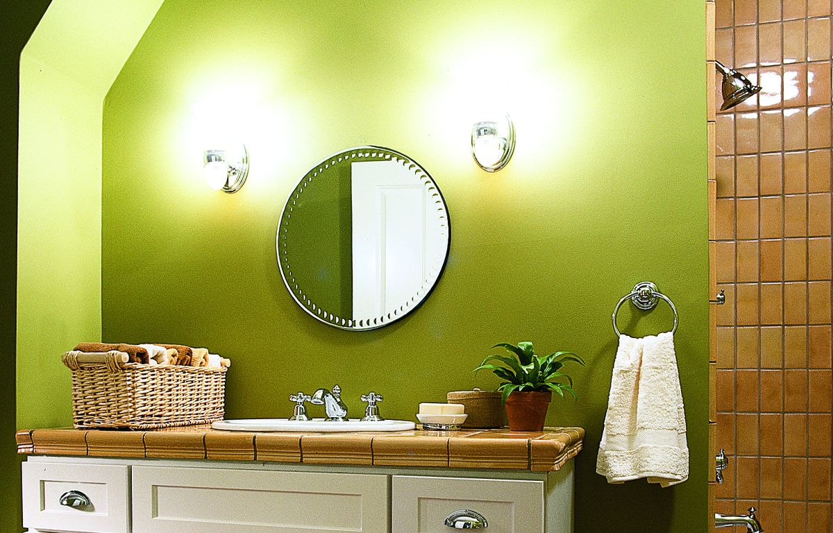 <p>In this children's bath, the vanity lights are installed at standard height; the wall-hung mirror can be raised as the kids grow. Set on a separate switch, rope lighting hidden along the vanity's bottom edge functions as a night-light.</p>