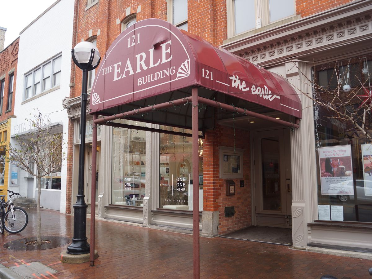 The red awning at the entrance to the Earle is shown on a rainy day in Ann Arbor.