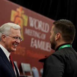 """Elder D. Todd Christofferson of the Quorum of the Twelve Apostles of The Church of Jesus Christ of Latter-day Saints speaks with Daniel Button after presenting """"Techniques for Family Unity from Mormon Homes"""" at the World Meeting of Families in Philadelphia on Thursday, Sept. 24, 2015."""