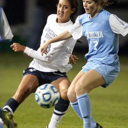 BYU's Lindsi Cutshall and North Carolina's Kealia Ohai fight for the ball during a women's soccer game at BYU in Provo on Friday, Nov. 23, 2012. North Carolina won 2-1 in double overtime.