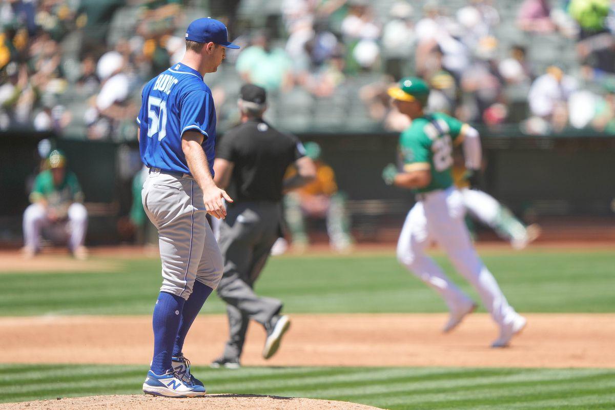 Kansas City Royals starting pitcher Kris Bubic (50) reacts as Oakland Athletics first baseman Matt Olson (28) circles the bases during the third inning at RingCentral Coliseum.