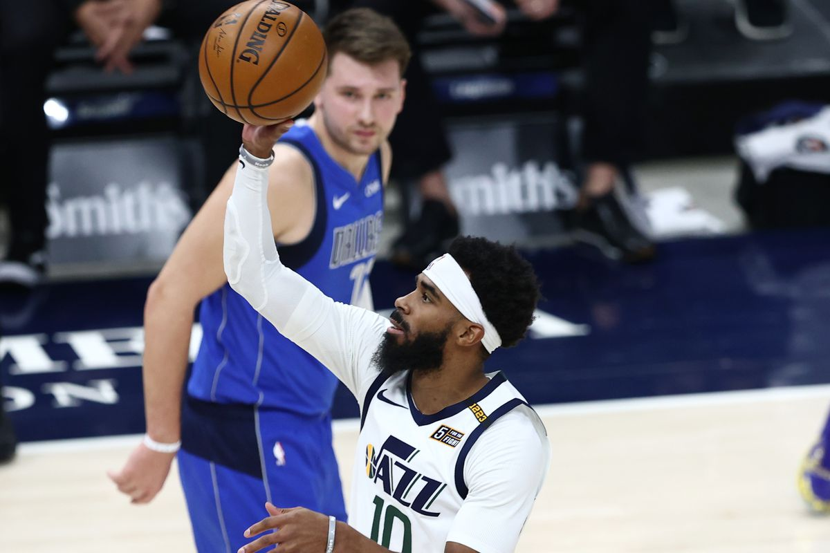 Utah Jazz guard Mike Conley (10) pushes up a shot as the Utah Jazz and the Dallas Mavericks play an NBA basketball game at Vivint Smart Home Arena in Salt Lake City on Wednesday, Jan. 27, 2021.