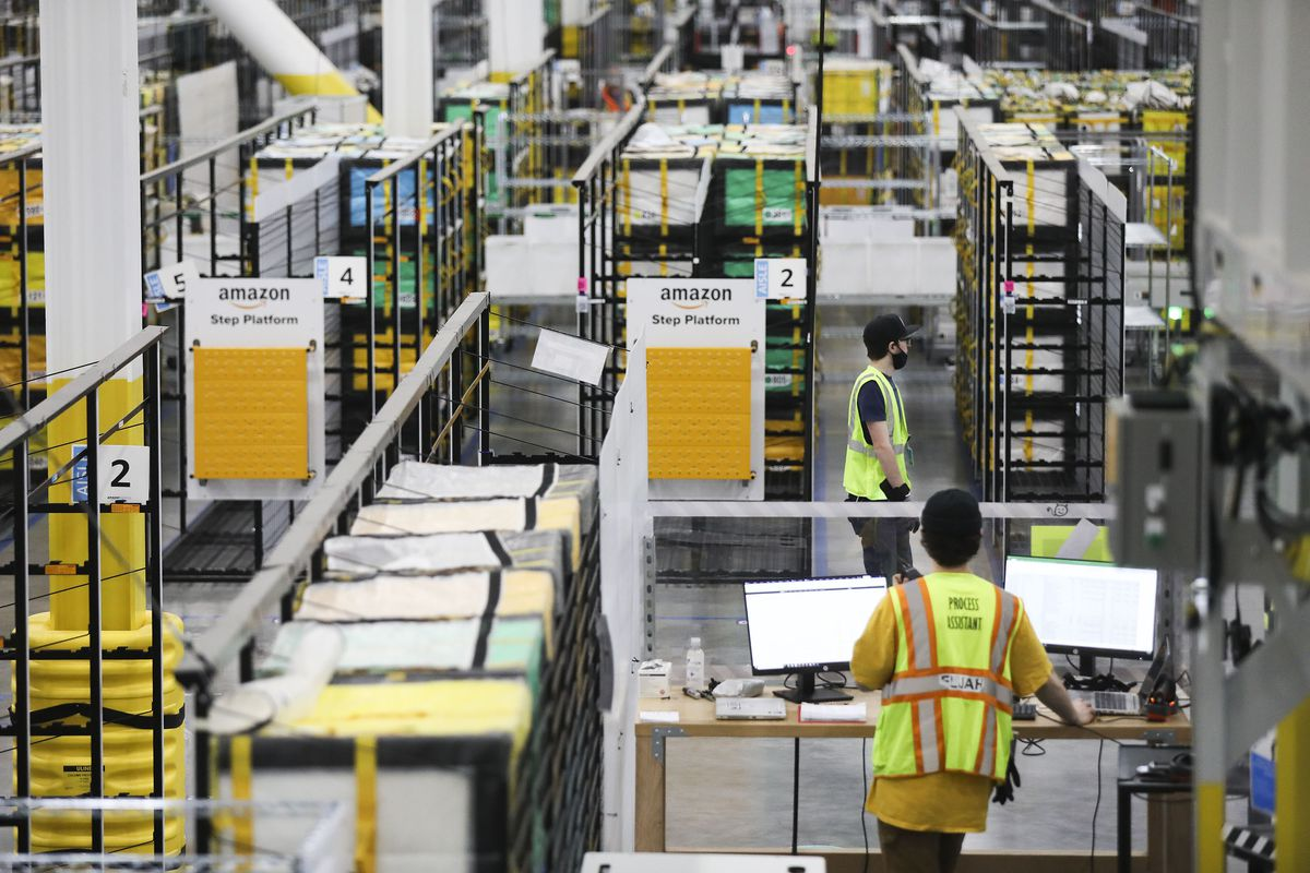 Employees work at Amazon's new delivery center in American Fork on Thursday, May 20, 2021.