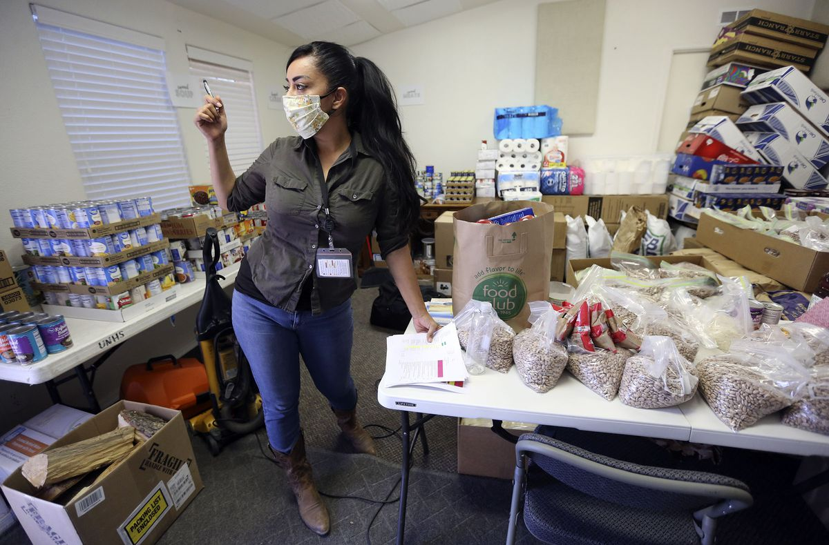 Sahar Khadjenoury, Utah Navajo COVID-19 Reliefprogramproject coordinator, organizes a list of elders who need food donations at Utah Navajo Health System in Montezuma Creek, San Juan County, on Wednesday, April 29, 2020. TheNavajo Nation has one of the highest per capita COVID-19 infection rates in the country.