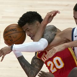 Atlanta Hawks forward John Collins (20) and Utah Jazz center Rudy Gobert (27) fight for control of the ball in the second half of an NBA basketball game Thursday, Feb. 4, 2021, in Atlanta.