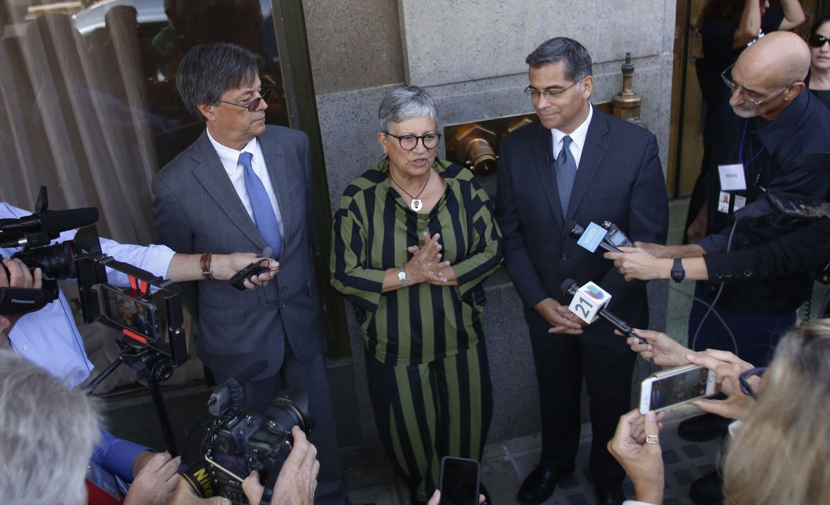 California leaders, from left to right, Cal/EPA Secretary Matthew Rodriguez, California Air Resources Board Chair Mary Nichols and California Attorney General Xavier Becerra talk to the media after speaking during the first of three public hearings on the