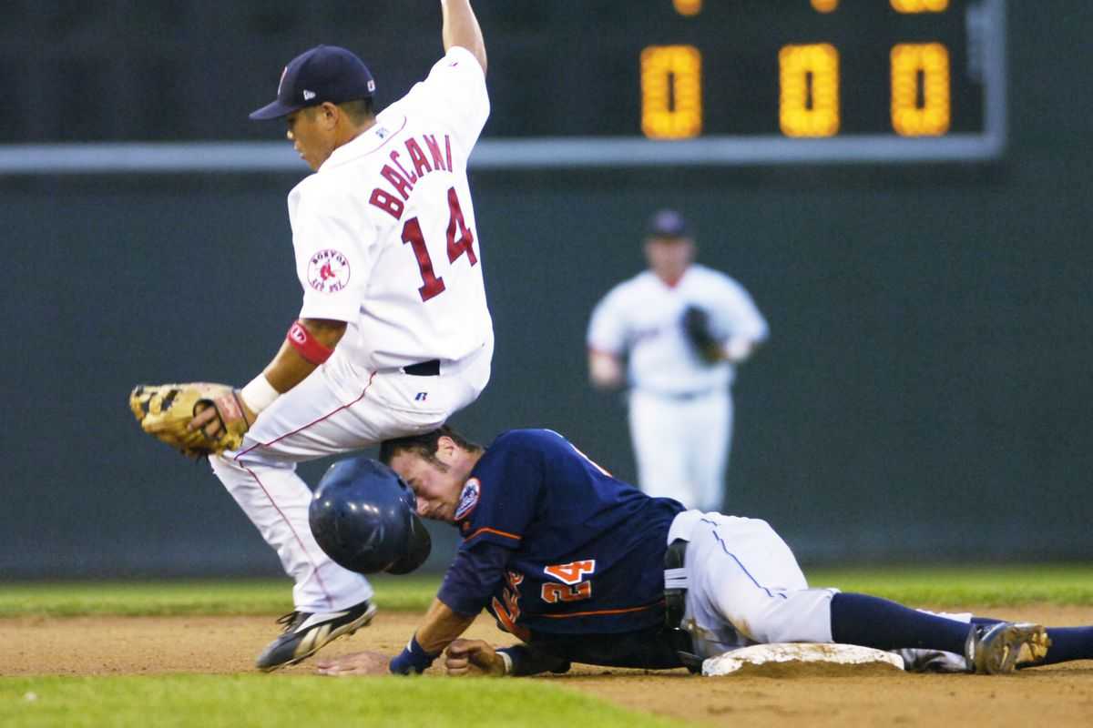 Binghamton Mets #24, Corey Ragsdale, collides with Sea Dogs #14, David Bacani, after being forced ou...