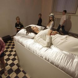 """Visitors view an art project called """"Sleeping Beauties,"""" created by artist Taras Polataiko for The National Art Museum in Kiev."""