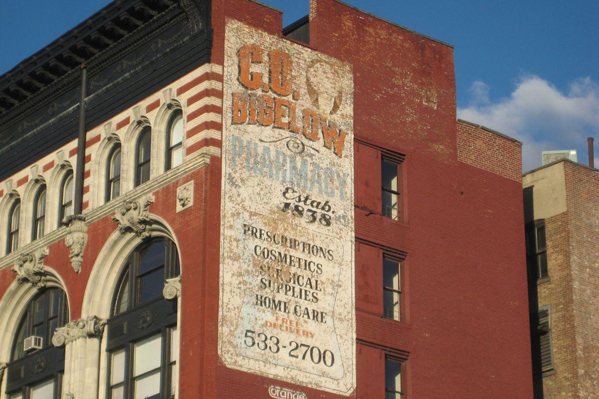 "The sign outside C.O. Bigelow via <a href=""https://ephemeralnewyork.wordpress.com/2012/09/17/the-most-iconic-faded-ad-in-greenwich-village/"">Ephemeral New York</a>"