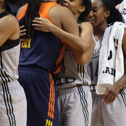 Connecticut Sun's Morgan Tuck (33) and San Antonio Stars' Moriah Jefferson (4) embrace after the game. The pair won four NCAA championships at UConn.