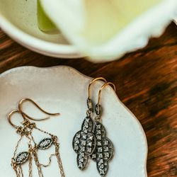 """Drapey earrings (left), <a href=""""http://blancamonrosgomez.com/collections/earrings/products/oval-filigree-drape-earrings"""">$910</a>; Dangly filigree earrings, <a href=""""http://blancamonrosgomez.com/collections/earrings/products/large-filigree-earrings"""">$2,0"""