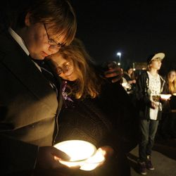 Matthew Owings and his mother JoVonn along with Powell family friends and well wishers hold a candlelight vigil in Salt Lake County  Sunday, Feb. 5, 2012. Josh Powell and his two sons were killed in an explosion in Washington.