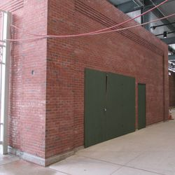 5:19 p.m. The interior side, along the Sheffield Avenue wall, next to the main bleacher gate -