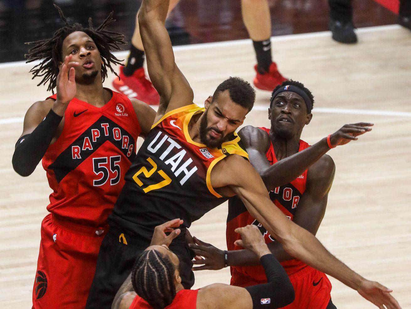 Utah Jazz center Rudy Gobert (27) fights Toronto Raptors as the Utah Jazz and the Toronto Raptors play an NBA basketball game at Vivint Smart Home Arena in Salt Lake City on Saturday, May 1, 2021.