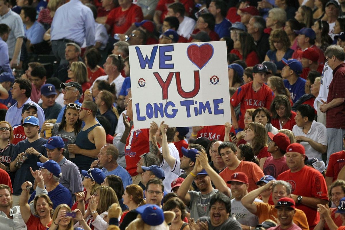 Apr 9, 2012; Arlington, TX, USA; Texas Rangers fans hold up a sign supporting starting pitcher Yu Darvish (11) during the game against the Seattle Mariners at Rangers Ballpark.  Mandatory Credit: Matthew Emmons-US PRESSWIRE