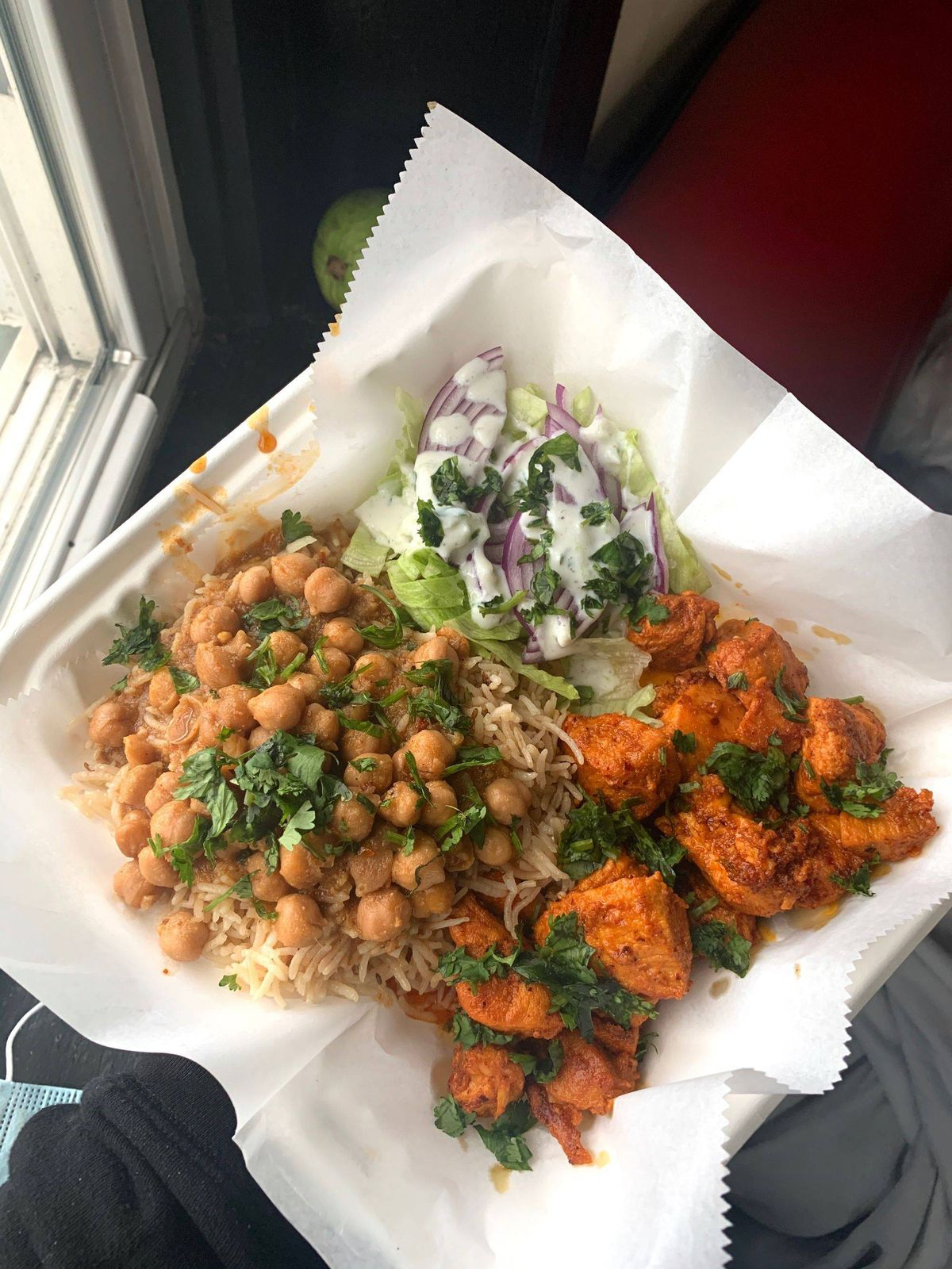 Jaya's tiffin has chicken kebabs, chickpeas, rice, and a salad with mint chutney