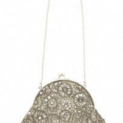 "<a href=""http://www.davidsbridal.com/Browse_Accessories-Handbags-All-Handbags__pageSize-all""> David's Bridal Victorian beaded bag</a>, $39.50 davidsbridal.com"