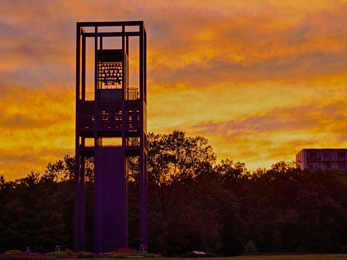 The Netherlands Carillon monument against a sunset in the sky in Washington D.C.