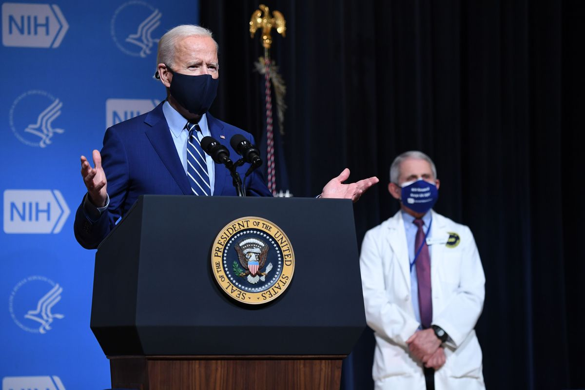 President Joe Biden, flanked by White House Chief Medical Adviser on Covid-19 Dr. Anthony Fauci during a visit to the National Institutes of Health in Bethesda, Maryland, on Feb. 11, 2021.