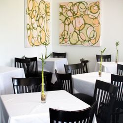 Dining room, with artwork by Amanda Stone Talley.