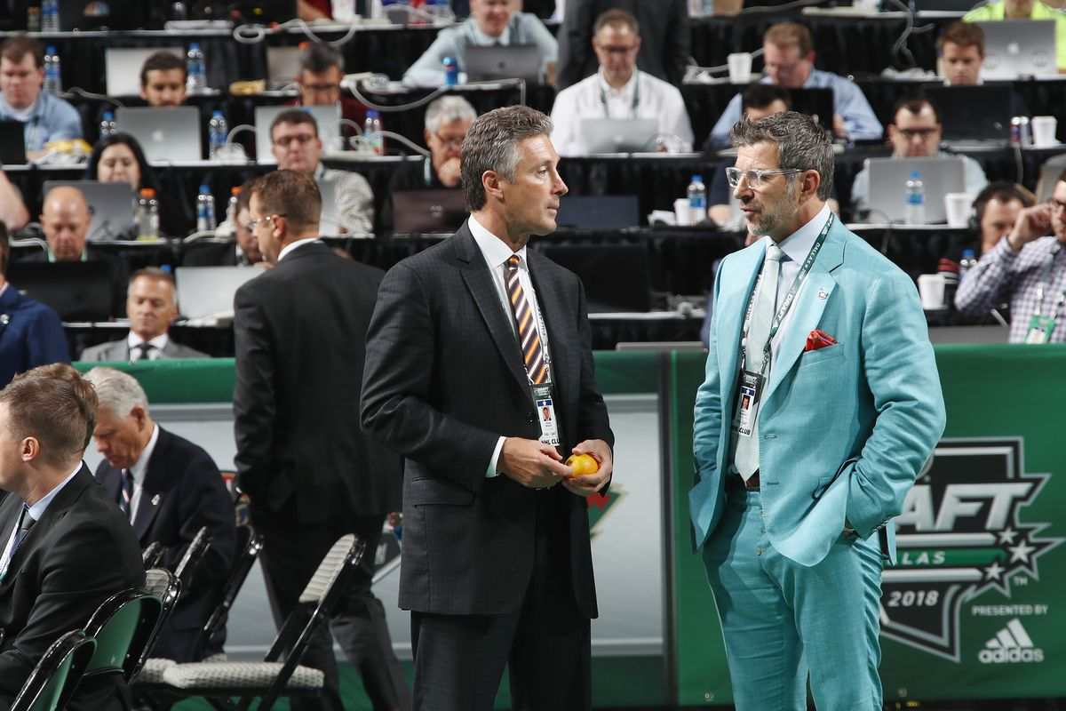 DALLAS, TX - JUNE 23: (l-r) Doug Wilson and Marc Bergevin attend the 2018 NHL Draft at American Airlines Center on June 23, 2018 in Dallas, Texas.