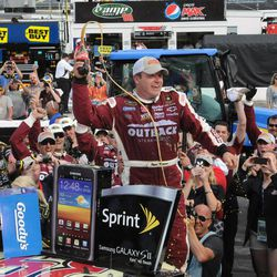 Ryan Newman celebrates in victory lane after winning the NASCAR Sprint Cup Series auto race Sunday, April 1, 2012, in Martinsville, Va.