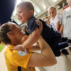 Utah Royals FC forward Amy Rodriguez (8) brings her son Luke onto the pitch after a match against the Orlando Pride at Rio Tinto Stadium in Sandy on Wednesday, May 9, 2018.