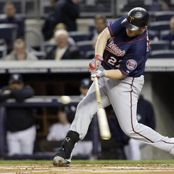 Minnesota Twins' Chris Parmelee hits a single during the first inning against the New York Yankees at Yankee Stadium in New York, Wednesday, April 18, 2012.